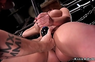 Busty slave with head in box whipped