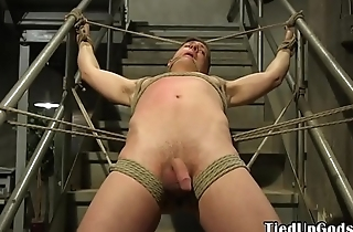 Submissive prisoner flogged by jail guard