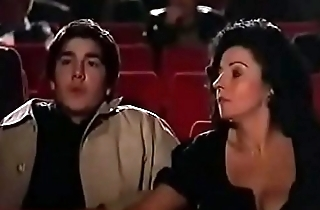 Milf jerks off young guy at the theater