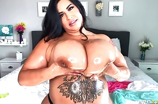 Hot BBW oils her immense boobs and plays with them