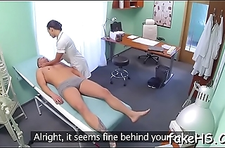 Seductive doctor widens her legs