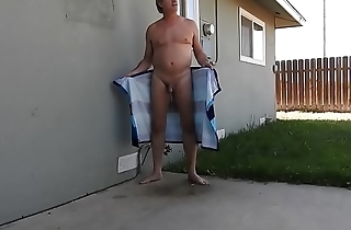 A daddy wrapped in a towel, opens it, and pees.