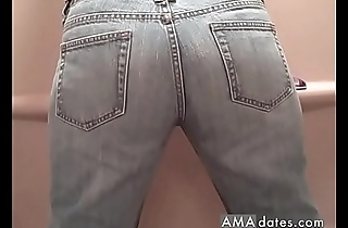 Busty MILF pissing in her pants